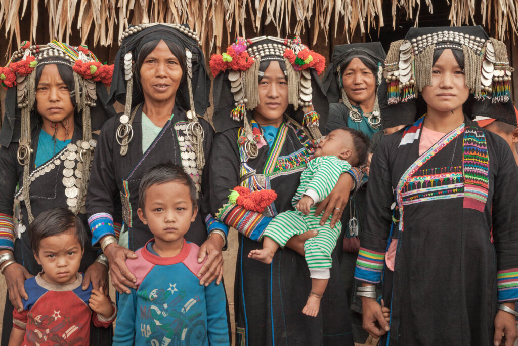Akha women and their children - girl gone authentic - the people